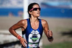 girl runner finishing race hard light