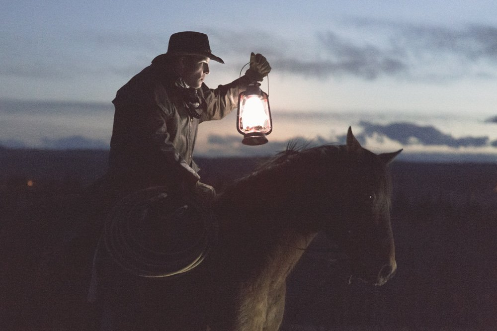 cowboy on horse with lantern hard light