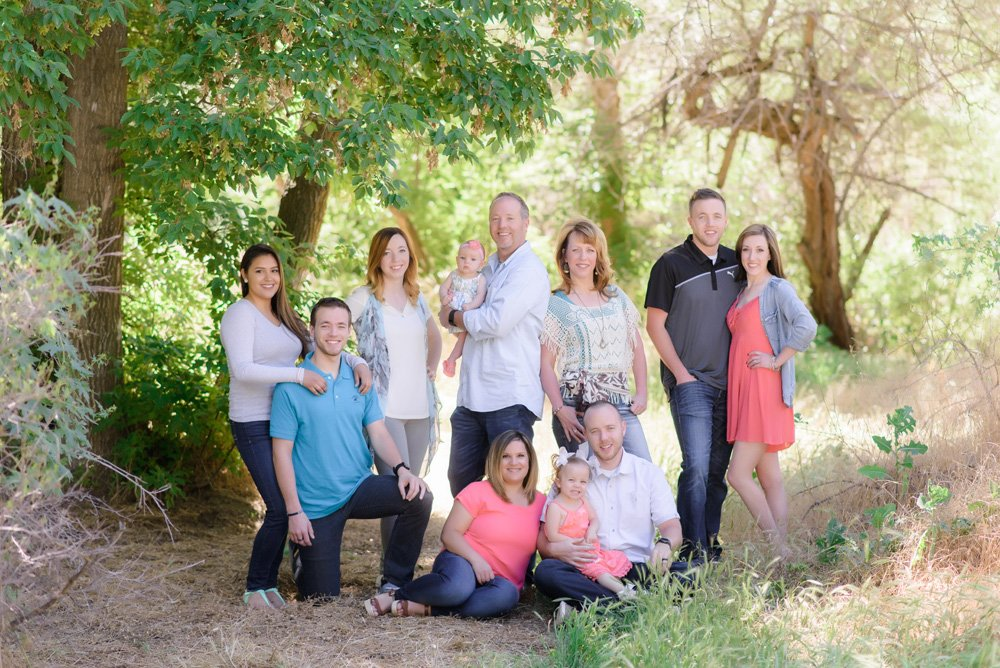 family portrait under tree in shade