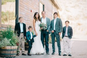 wedding family group next to barn