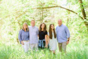 family portrait in sun under tree