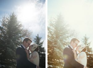 bride and groom with sun flare and pine trees