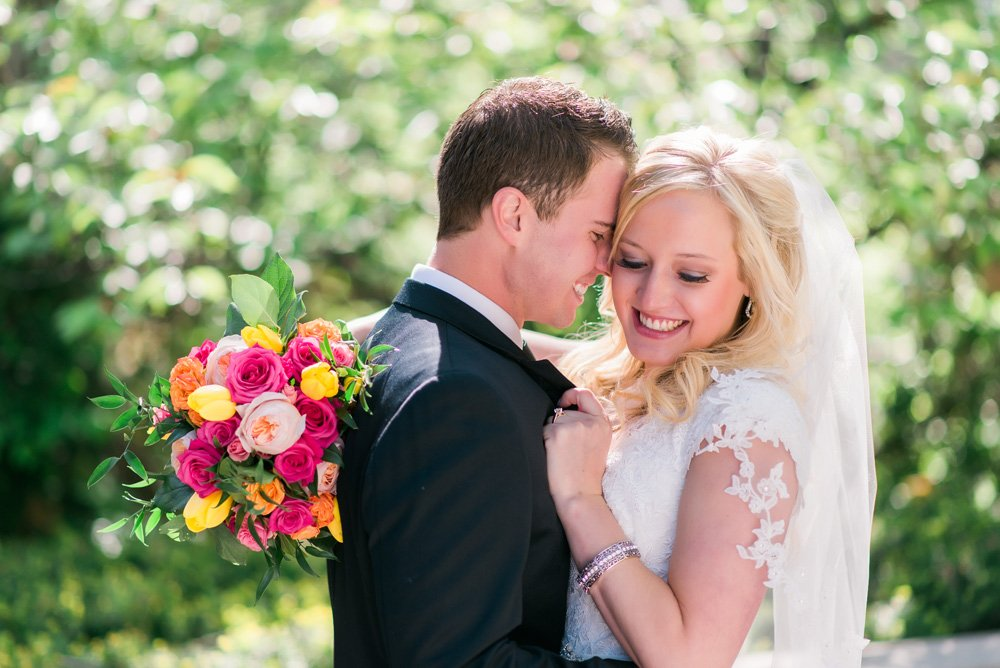 bride and groom snuggling