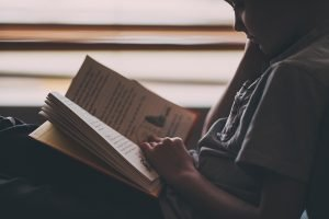 young boy reading shot at high ISO