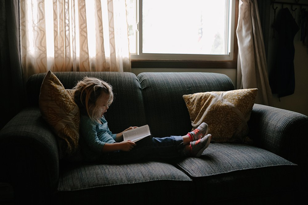 young girl reading shot at high iso