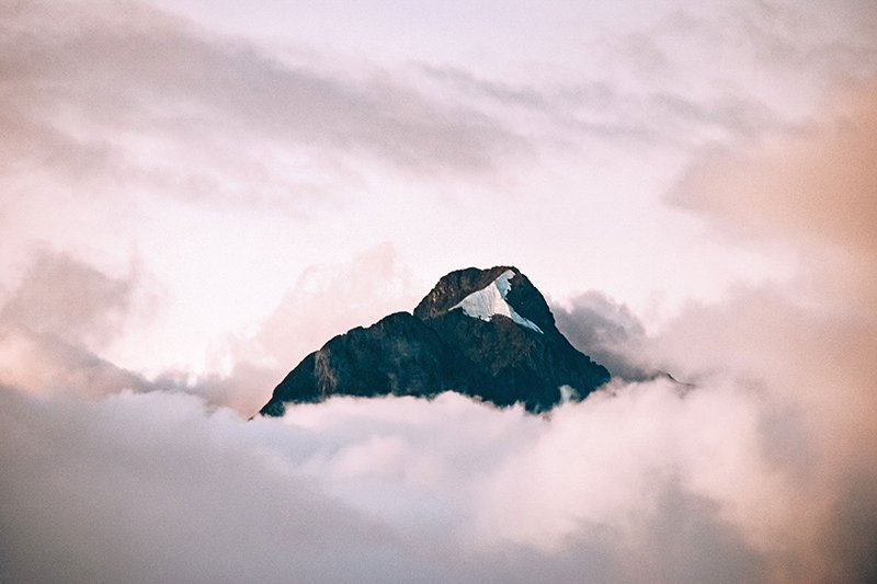 framing a mountain with clouds in photography