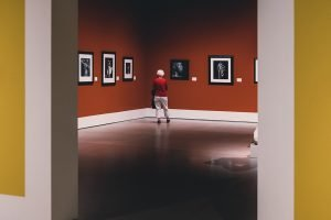woman in gallery framed by walls