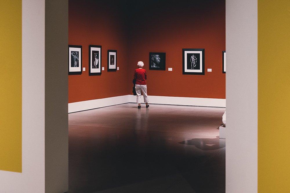 woman in gallery framed by walls