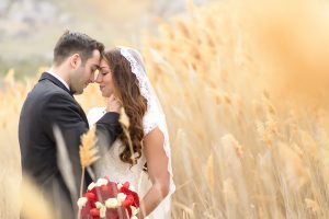 couple framed by wheat