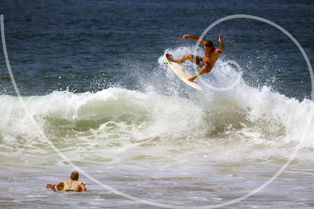 image of surfers composed using fibonacci spiral