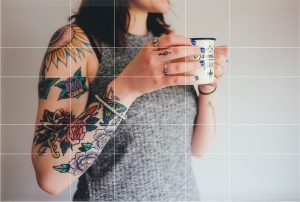 golden rectangle lines on image of girl holding coffee