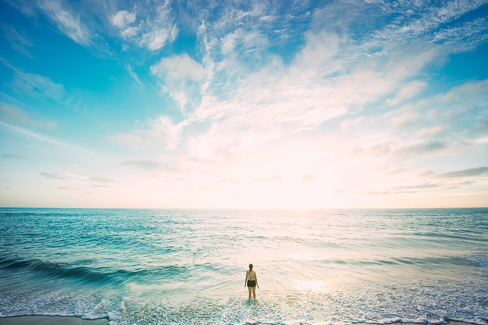 girl standing in an ocean