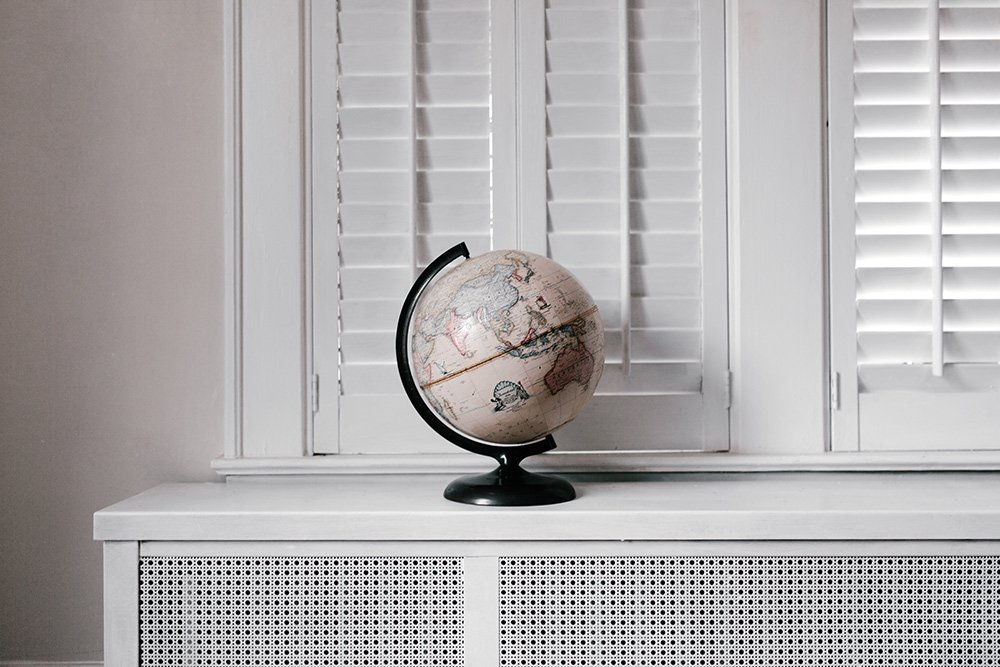 globe sitting on shelf