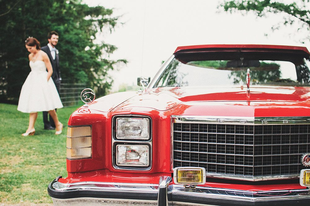 bride and groom with car from 70s