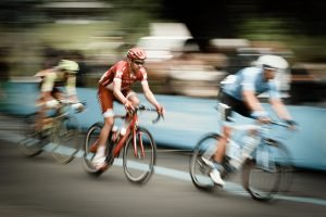 road bikers blurred by movement in a bike race