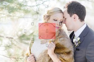 bride and groom snuggling with center weighted metering icon