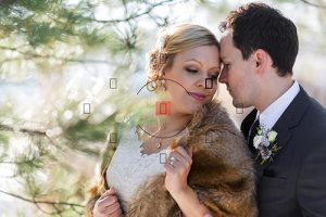 bride and groom snuggling with spot metering icon