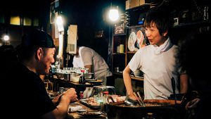 a dinner scene in a restaurant in chinatown