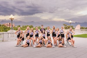 an image of cheerleaders with the sky darkened by using the range mask with the graduated filter in Lightroom Classic.