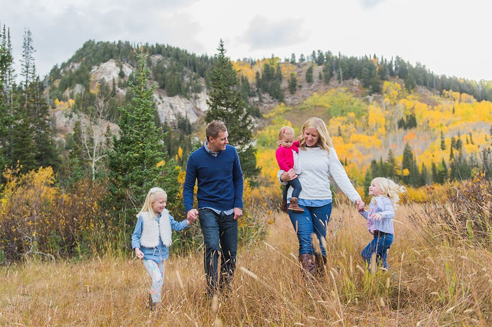 image of family walking together in the mountains in autumn