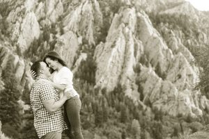 sepia tone image of a couple in the mountains snuggling.