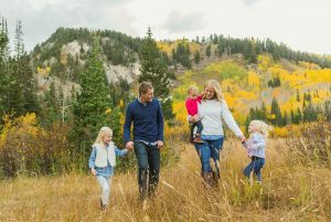 image of family walking together in the mountains in autumn with added warmth from the split toning panel in lightroom