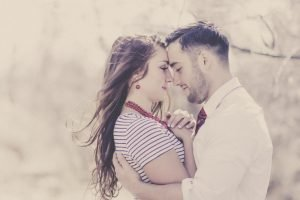 image of engaged couple snuggling together with edits made using virtual copies in lightroom