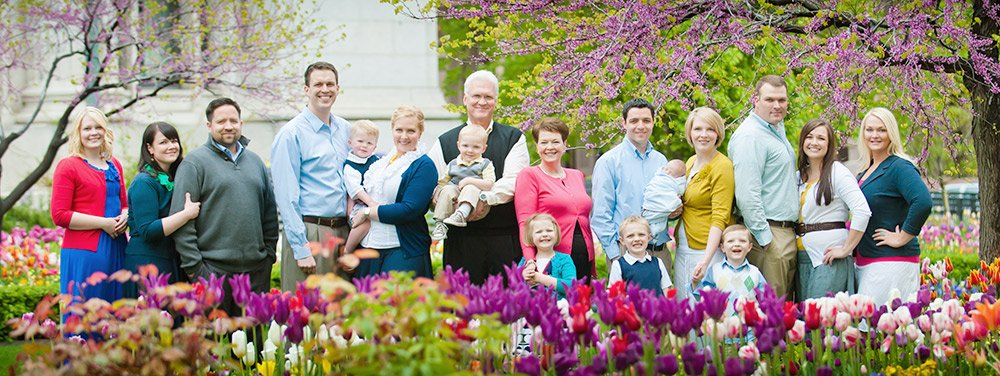 a large family group in flowers cropped slim